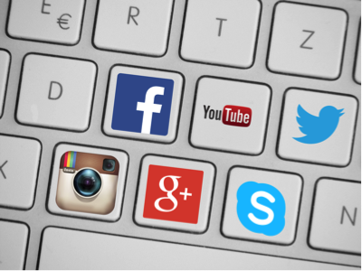 Graphic of keyboard with social media icons on buttons (facebook, youtube, twitter, instagram, google, and skype)