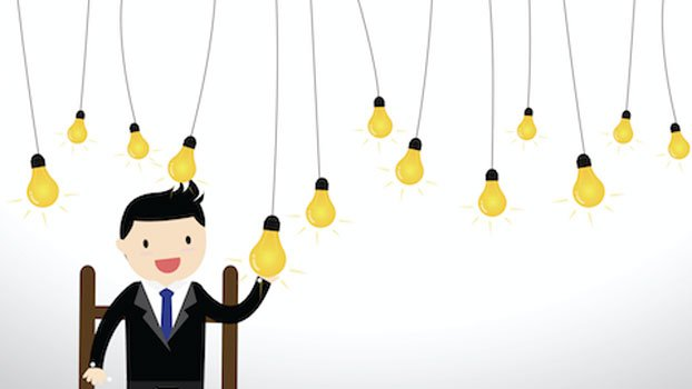 Cartoon of a man touching one of many light bulbs hanging above