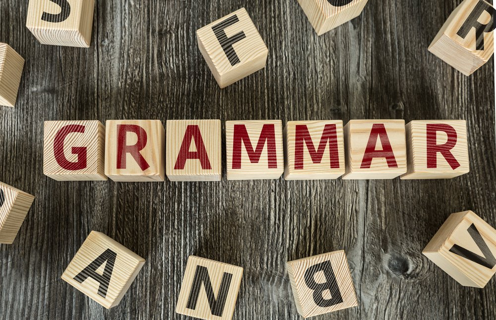 """Letter blocks spelling out the word """"Grammar"""" in red letters"""