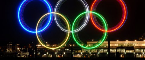 Photo of olympic rings at night