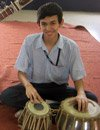 student playing drum
