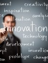 "Man appears to write text on camera reads ""Innovation"" surrounded by other words"