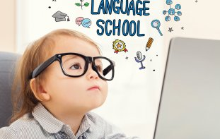 "Image of child wearing glasses with text saying ""Language School"""