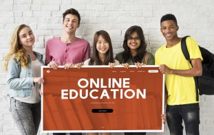 Young people holding a sign that reads: Online Education