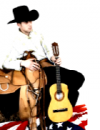 Photo of man wearing cowboy hat sitting and holding a guitar