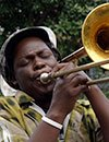 Photo of jazz musician blowing horn